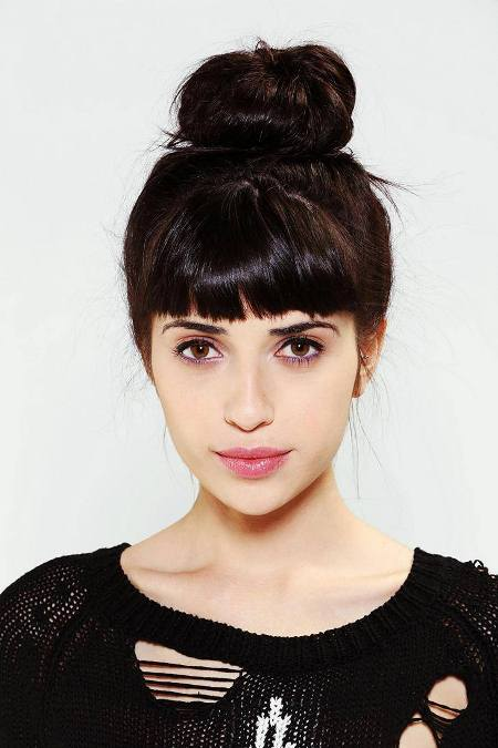 blunt fringes with coiled bun knot hairstyles