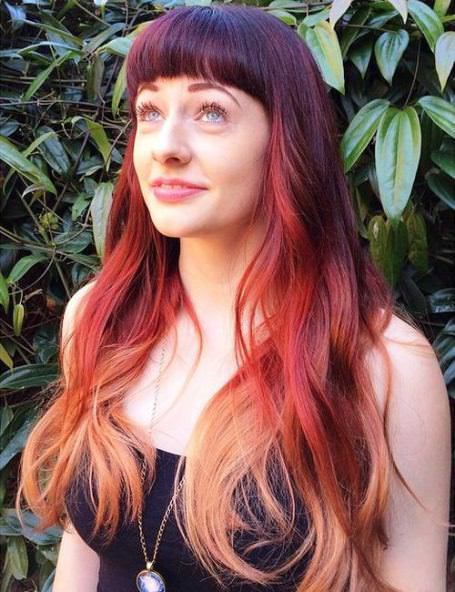 Blunt bangs and length red ombre hair