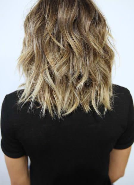 a long and statement hairstyles for thick hair